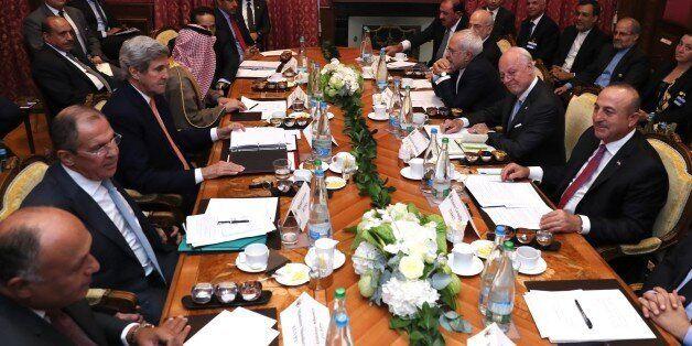 LAUSANNE, SWITZERLAND - OCTOBER 15: Turkish Foreign Minister Mevlut Cavusoglu (R), United States Secretary...