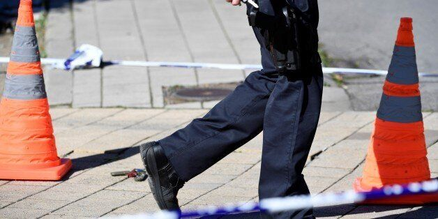 A security perimeter has been set around n the scene where two police officers were stabbed on October...