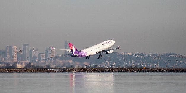 A Hawaiian Airlines Airbus A330-200 takes off at San Francisco International Airport, San Francisco,...