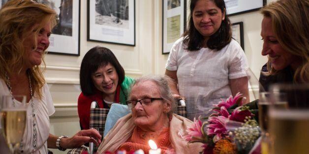 Veteran British war correspondent Clare Hollingworth (C) attends a celebration to mark her 105th birthday...