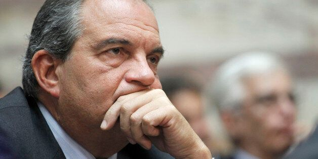Conservative former prime minister Costas Karamanlis listens the speech of conservative opposition leader...
