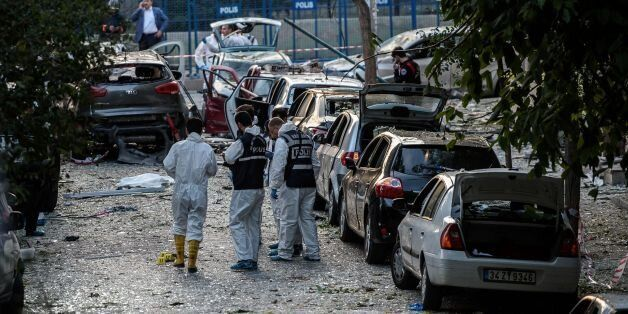 Forensic officers work at the scene of a blast near a police station in Istanbul on October 6, 2016....