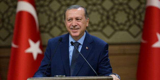 Turkey's President Recep Tayyip Erdogan addresses a group of local administrators in Ankara, Turkey,...