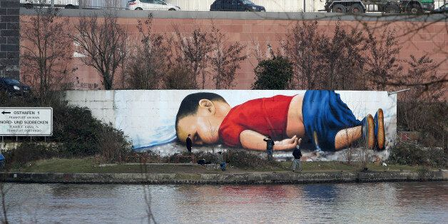 A graffiti by artists Justus Becker and Oguz Sen depicts the drowned Syrian refugee boy Alan Kurdi (initially...