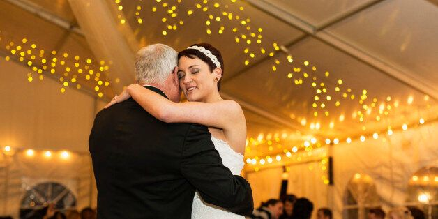 Bride dancing with father at
