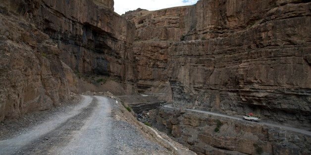 In this Aug. 15, 2016, photo, a car drives along a mountain road that leads to Spiti Valley, a remote...