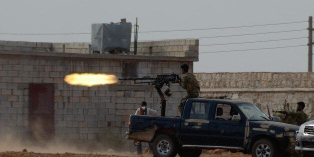 ALEPPO, SYRIA - OCTOBER 4: Free Syrian Army (FSA) members attack Daesh terrorist in Turkmen Barih village...