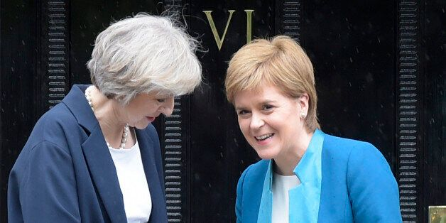 Britain's new Prime Minister Theresa May (L) is greeted by Scotland's First Minister Nicola Sturgeon...