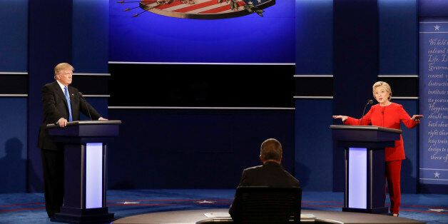 Democratic presidential nominee Hillary Clinton answers a question as Republican presidential nominee...