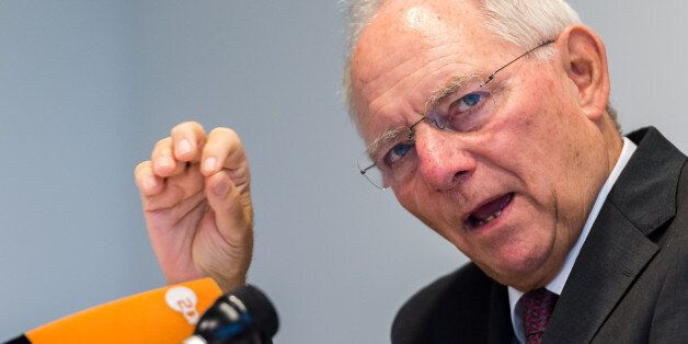 German Finance Minister Wolfgang Schauble addresses the media after a meeting of EU economy and finance...