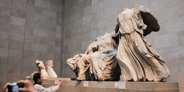 Tourists visit the Parthenon gallery at the British Museum in London, on March 30, 2015. A legal team...