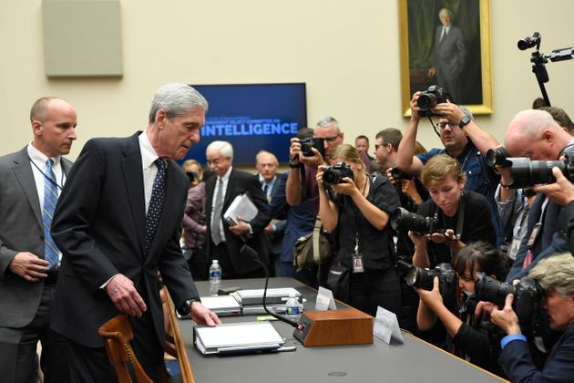 Former special counsel Robert Mueller returns to the witness table following a break in his July 24 testimony...