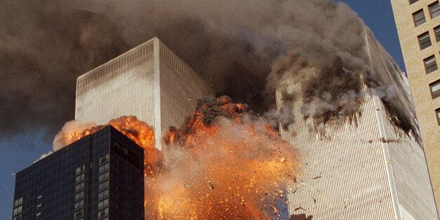 FILE - In this Sept. 11, 2001, file photo, smoke billows from one of the towers of the World Trade Center...