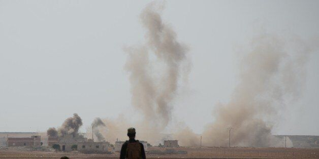 ALEPPO, SYRIA - OCTOBER 4: Smoke rises after Free Syrian Army (FSA) members attack Daesh terrorist in...