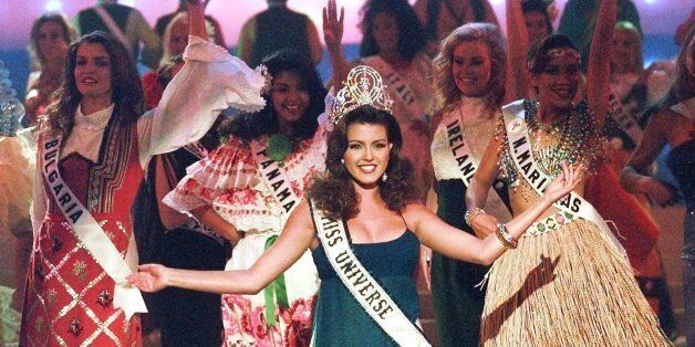 The 1996 reigning Miss Universe, Alicia Machado of Venezuela, joins in the opening number during the...
