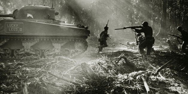 Side profile of army soldiers with a military tank in a forest, Battle of Bougainville, US Military,...