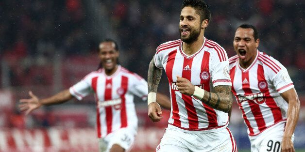 Olympiakos' Manuel Da Costa from Morocco, front, celebrates after scoring against Panathinaikos during...