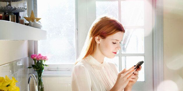 woman texting on mobile in