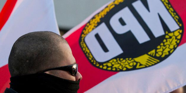 A supporter of the far-right nationalist National Democratic Party of Germany (NPD) attends a rally in...