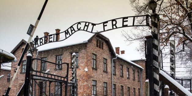 Arbeit macht frei sign at Auschwitz Concentration Camp, a UNESCO World Heritage Site, Oswiecim near Krakow,...