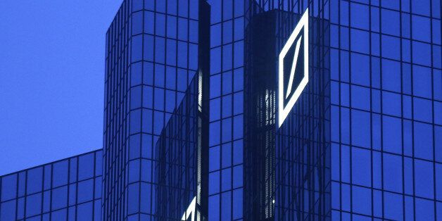 FILE - In this Dec. 10, 2015 file photo the headquarters of Deutsche Bank is photographed in Frankfurt,...