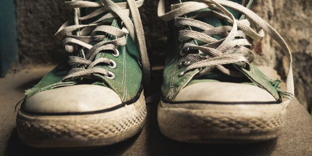 Old green converse shoes and worn