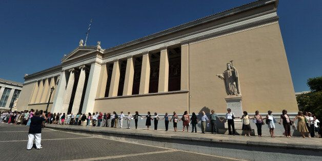 Univercity professors form a human chain in front of the University of Athens on September 27, 2012 as...