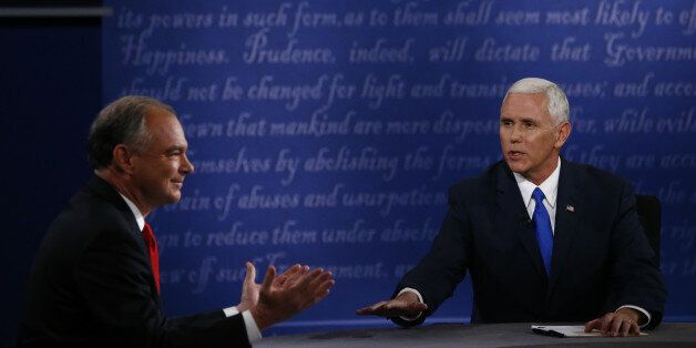 Mike Pence, 2016 Republican vice presidential nominee, right, speaks as Tim Kaine, 2016 Democratic vice...