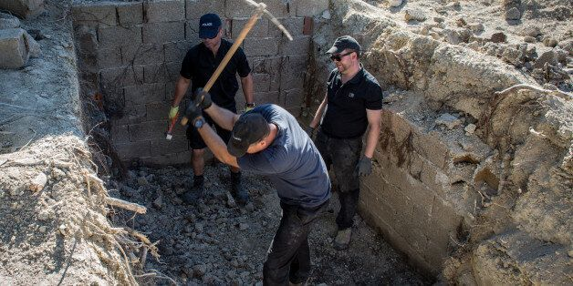 KOS, GREECE - SEPTEMBER 30: South Yorkshire Police work to excavate a sceptic tank in search of missing...