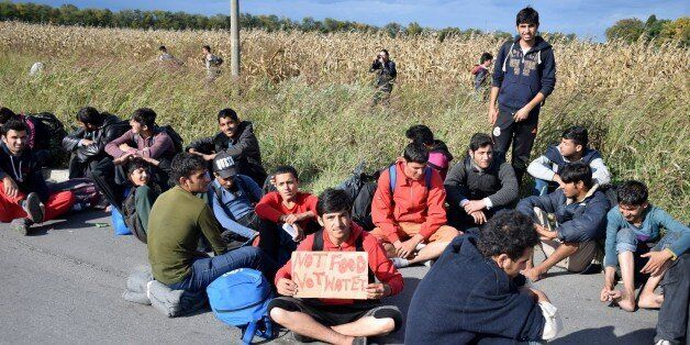 BELGRADE, SERBIA - OCTOBER 4: Refugees make their way to Hungarian border with Serbia near the town of...