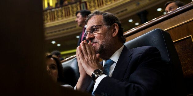 Spain's acting Prime Minister Mariano Rajoy attends the Spanish parliament in Madrid, Tuesday, July 19,...