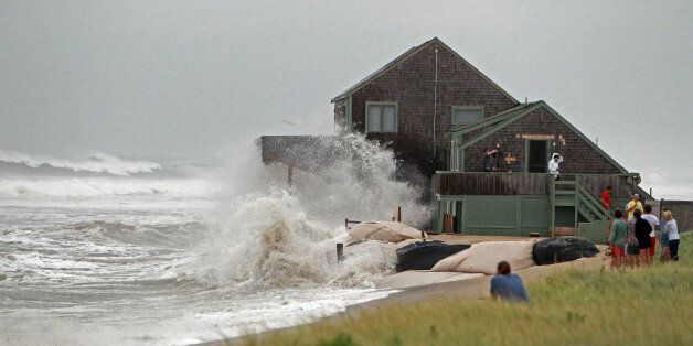 NANTUCKET, MA - SEPTEMBER 3: Neighbors gather to watch Gene Ratner's home on Sheep Pond Road get slammed...