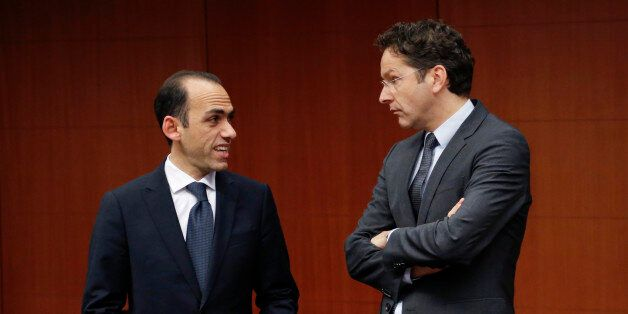 Cyprus' Finance Minister Harris Georgiades listens to Dutch Finance Minister and Eurogroup chairman Jeroen...