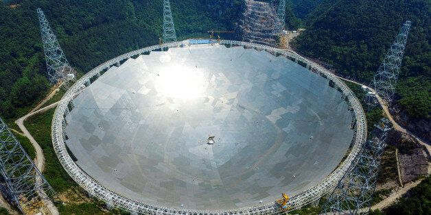 A 500-metre (1,640-ft.) aperture spherical telescope (FAST) is seen at the final stage of construction,...