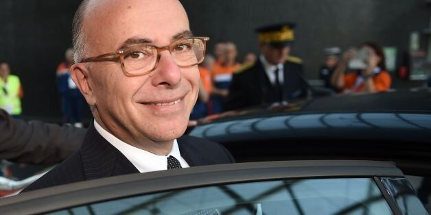 French Interior Minister Bernard Cazeneuve looks on as he leaves the national congress of the Civil Protection...