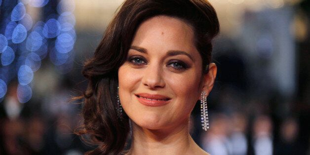 FILE PHOTO -- Cast member Marion Cotillard poses on the red carpet as they arrive for the screening of...
