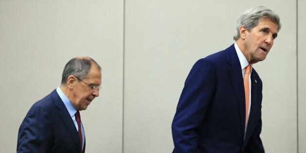 U.S. Secretary of State John Kerry (R) and Russian Foreign Minister Sergei Lavrov arrive for a news conference...