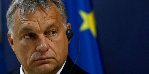 Hungary's Prime Minister Viktor Orban listens to a question during a press conference after talks with...