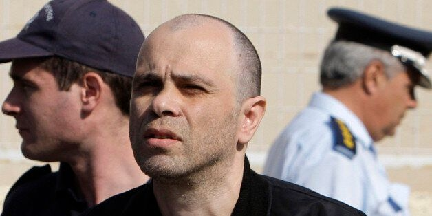 Alleged member of the Revolutionary Struggle group and suspected terrorist Nikos Maziotis is seen at...
