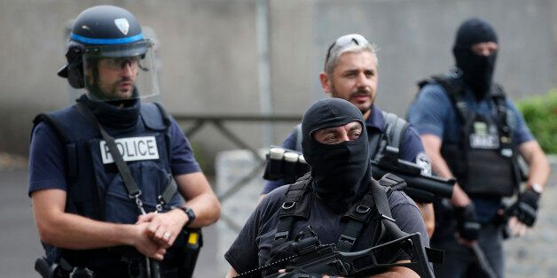 French police and anti-crime brigade (BAC) members secure a street as they carried out a counter-terrorism...