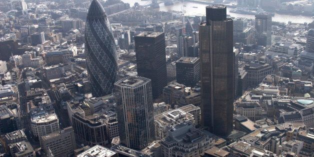 Aerial view south of 30 St. Mary AXe (The Gherkin), Tower 42, 99 Bishopsgate, Lloyd's Building and urban...