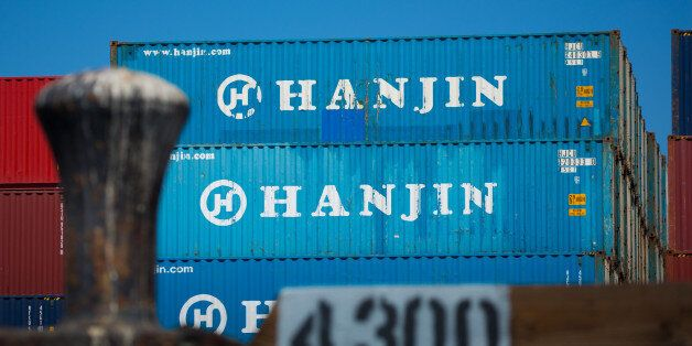 Containers sit stacked on the Hanjin Gdynia cargo ship berthed at the Port of Long Beach in Long Beach,...