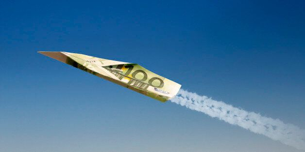 Airplane made of 100 EURO against blue