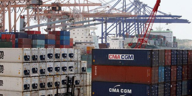 Container cranes at work in the Piraeus Container Terminal, operated by Chinese state-owned shipping...