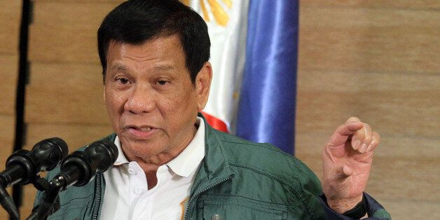 Philippine President Rodrigo Duterte speaks during a news conference in Davao after Norwegian national...