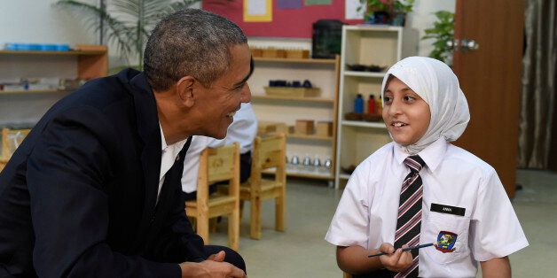 President Barack Obama, left, meets with children as he tours the Dignity for Children Foundation in...