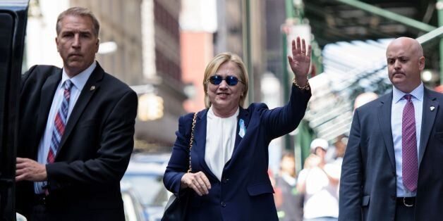 US Democratic presidential nominee Hillary Clinton waves to the press as she leaves her daughter's apartment...