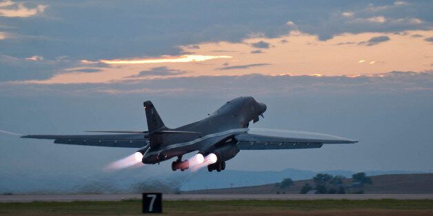 This July 24, 2012 photo provided by the U.S. Air Force shows a B-1 bomber rumbling down the flightline...