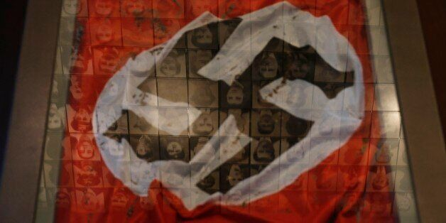 In this photo taken Saturday, March 21, 2015, a Nazi flag is displayed at the Holocaust Museum in the...