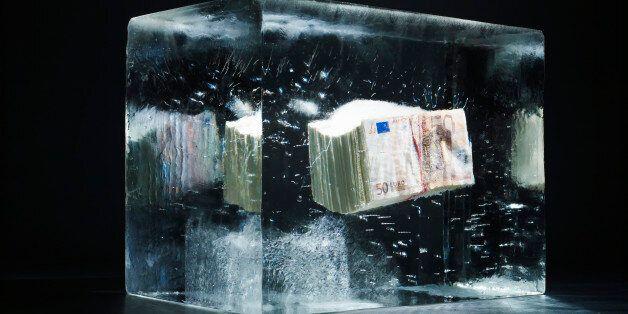 50 EUR money bundle being frozen in an ice